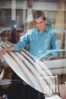 Man selecting surfboard  #415181