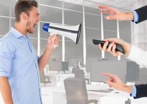 Male executive shouting on megaphone #415211