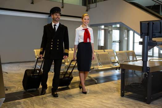 Pilot and air hostess walking with their trolley bags  #415224