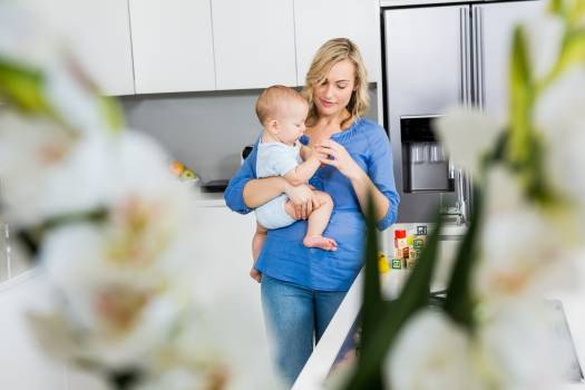 Mother holding her baby boy in kitchen #415294