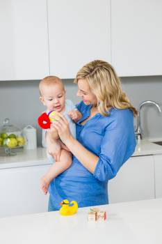 Mother holding her baby boy in kitchen #415295