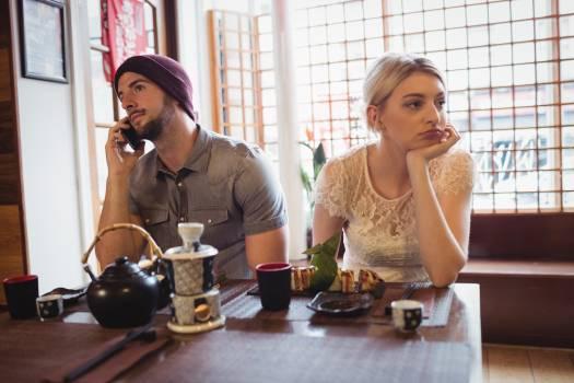 Man ignoring woman while talking on phone #415344