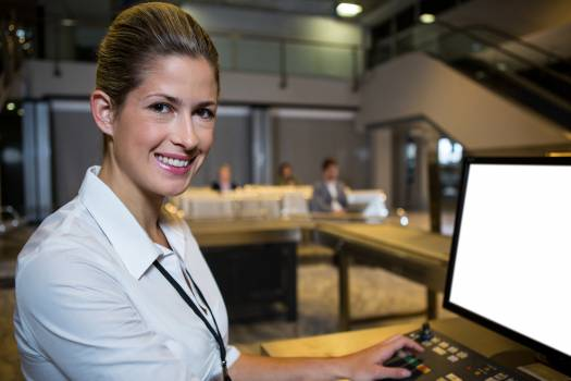 Female staff working in airport terminal #415371
