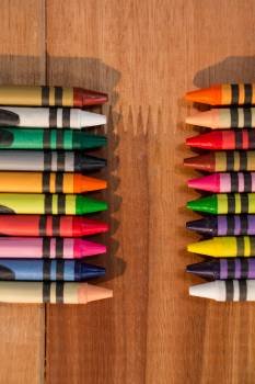Various color chalks on wooden table #415443