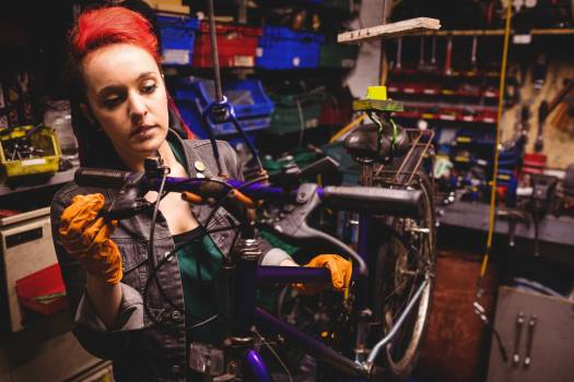 Mechanic repairing a bicycle #415568