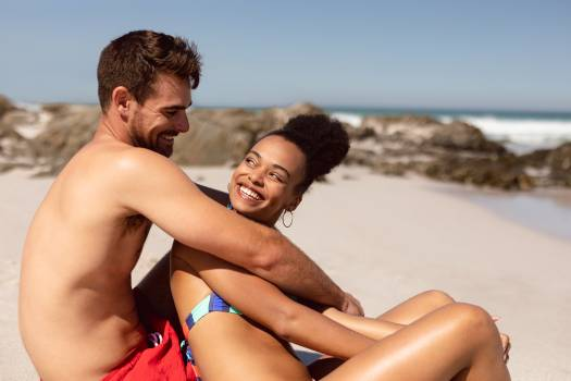 Young couple having fun on beach in the sunshine #415645