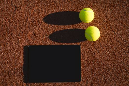 Tennis ball and digital tablet on ground #415665