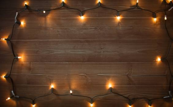 Rice lights illuminated on wooden plank #415688