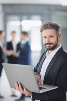 Businessman using laptop #415735