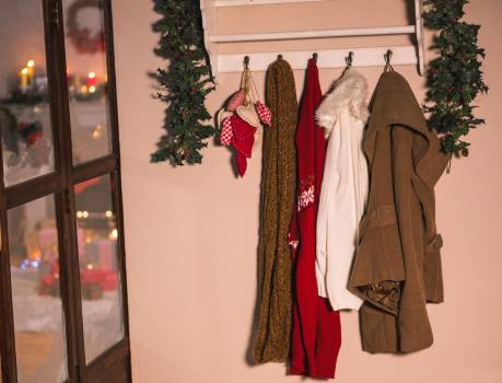 Winter wear hanging on hook hanger on wall #415759