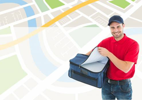 Delivery man holding parcel against location background #415778