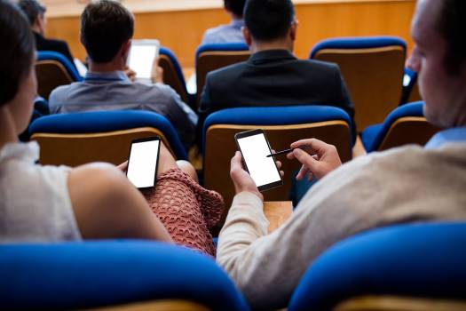 Business executives participating in a business meeting using mobile phone #415803