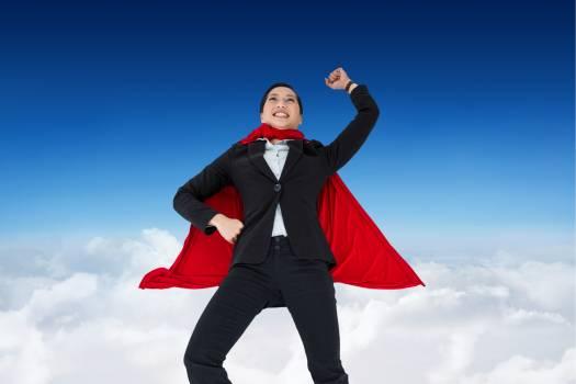 Businesswoman wearing  super hero cape in sky #415841