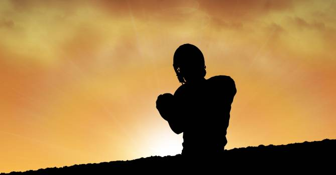 Silhouette man playing American football during sunset #415849
