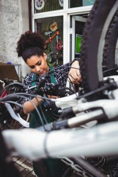 Mechanic examining bicycles #415945