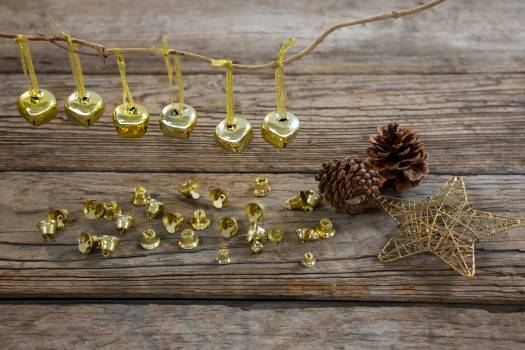 Christmas bells, pine cone and star on wooden plank #415972