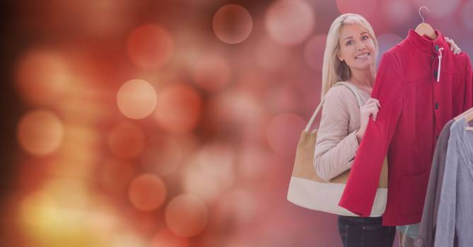 Portrait of woman buying new jacket over blur background #416064