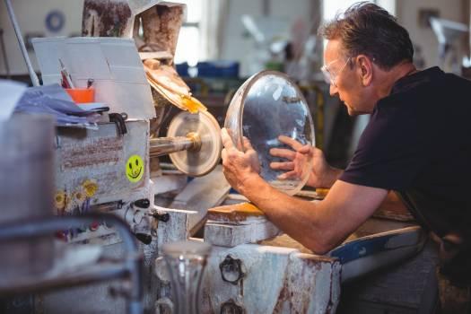 Glassblower working on a glass #416132