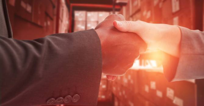 Close-up of business people shaking hands in warehouse #416203