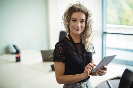 Businesswoman using digital tablet #416215