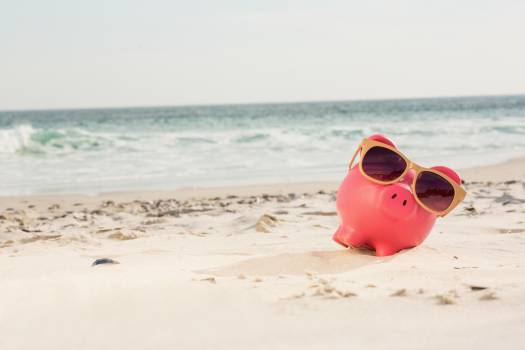 Piggy bank with sunglasses kept on sand #416268