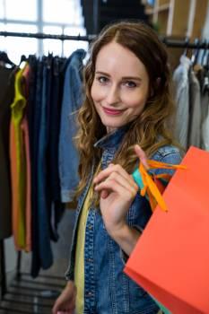 Beautiful woman carrying shopping bag #416345