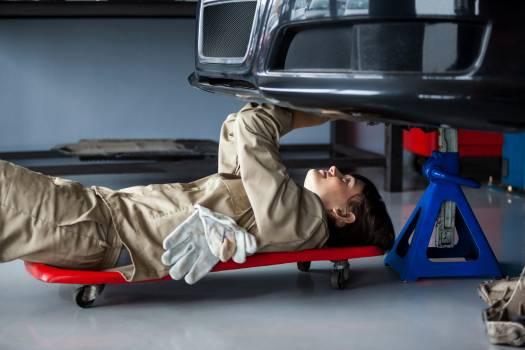 Female mechanic repairing a car #416354
