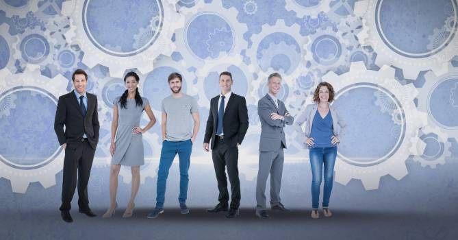 Digital composite image of business people with gears Free Photo