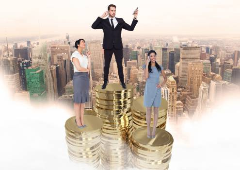 Business people standing on stacked gold coins #416383