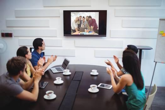 Business executive applauding during a video conference #416386