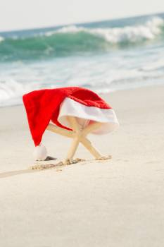 Starfish covered with santa hat kept on sand #416396