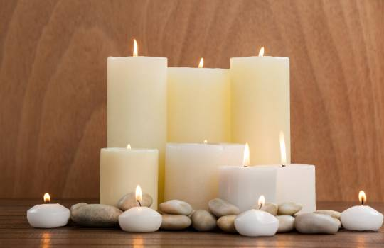 White candles and pebbles stone on wood #416413