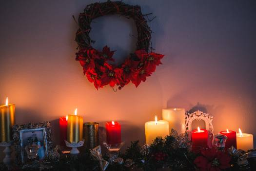 Candles and christmas decorations arranged on fireplace #416420