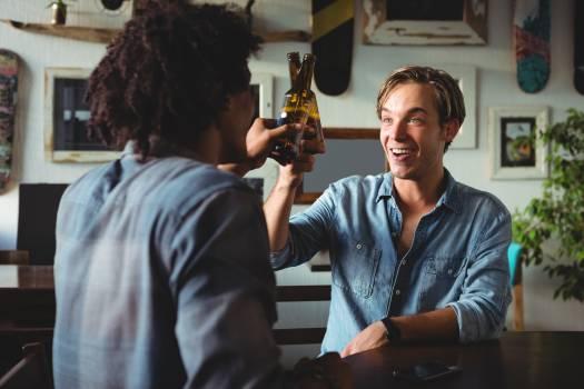 Friends toasting beer bottles #416521