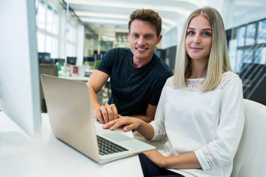 Portrait of male and female graphic designers smiling at camera #416540