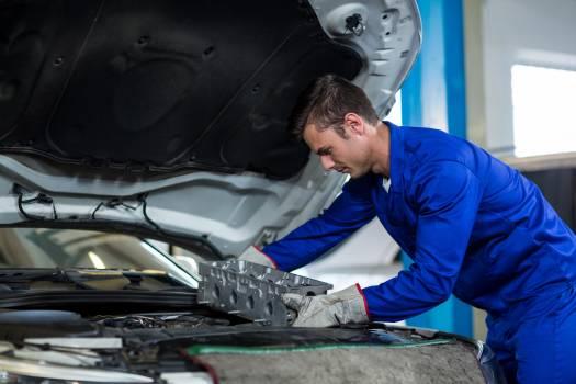 Mechanic installing car parts #416558