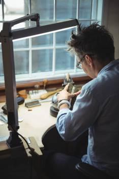 Craftswoman working in workshop #416568