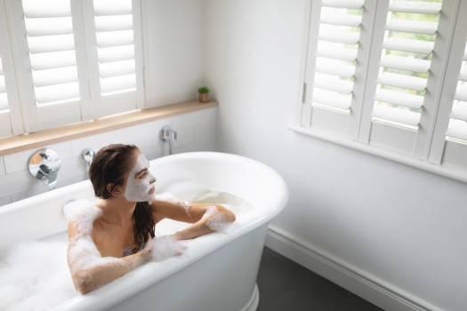 Woman relaxing in bathtub at bathroom #416580
