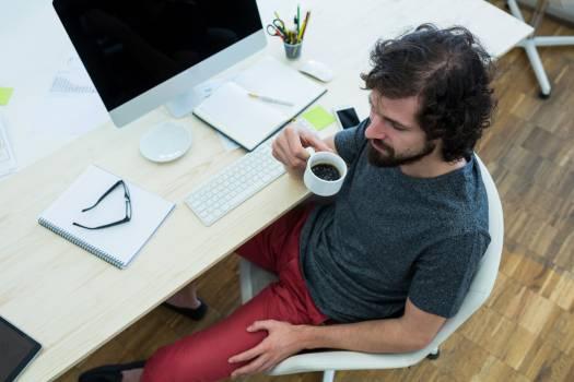 Male graphic designer having black coffee #416600