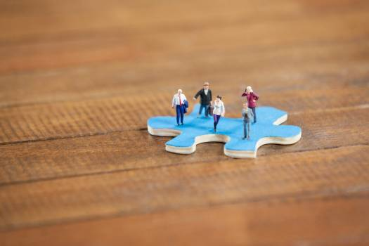Miniature people on a jigsaw puzzle #416602