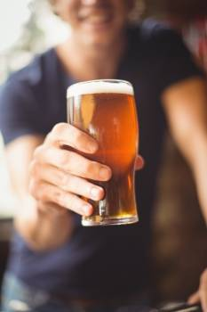 Close-up of man holding glass of beer #416649