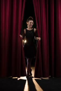 Ballet dancer peeking through a stage curtain #416678