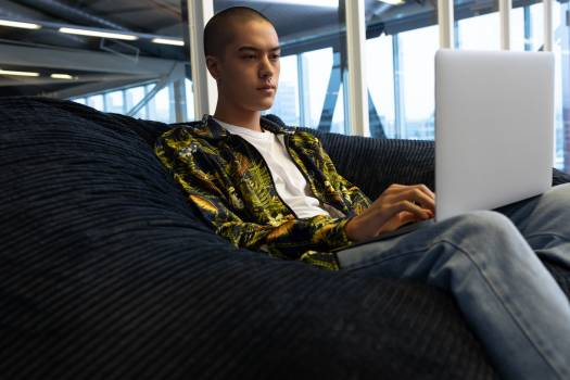 Businessman using laptop on a sofa in the office #416806