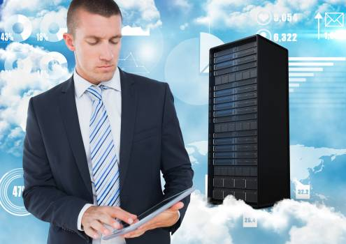 Businessman using digital tablet against server system in sky background #416838