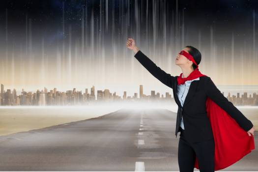 Digital composite of businesswoman in superhero costume on road in city #416853
