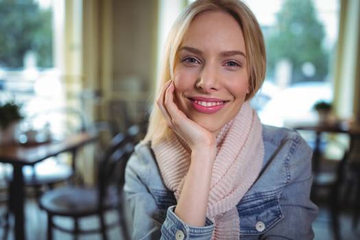 Smiling woman sitting in café #416878