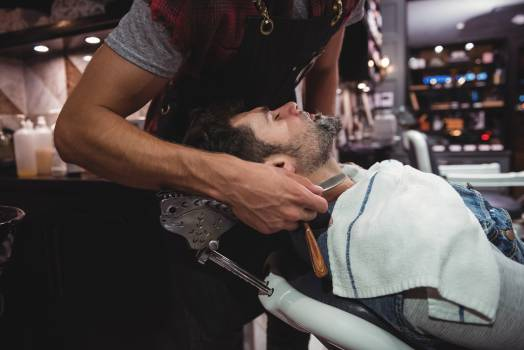 Man getting his beard shaved with razor #416892