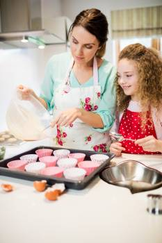 Mother and daughter preparing cupcake in kitchen #416897