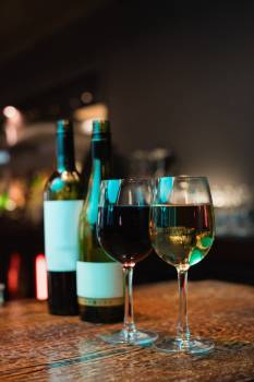 Glasses of red wine and bottles on bar counter #416913