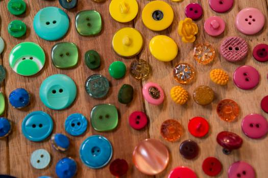 Various types of buttons on a table #417061